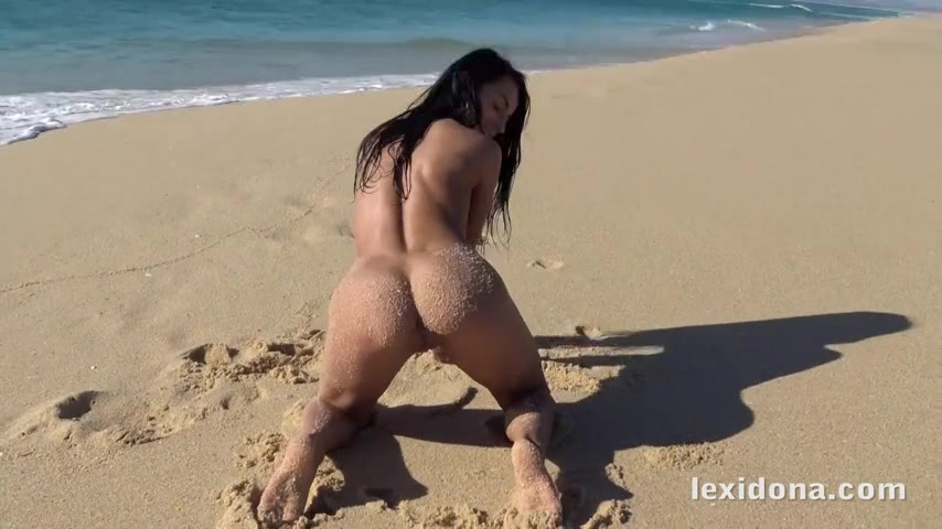 Lexi Dona is on the beach and playing with her wet pussy